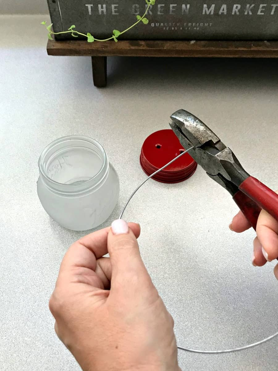 making DIY mason jar lanterns, cutting wire for lid