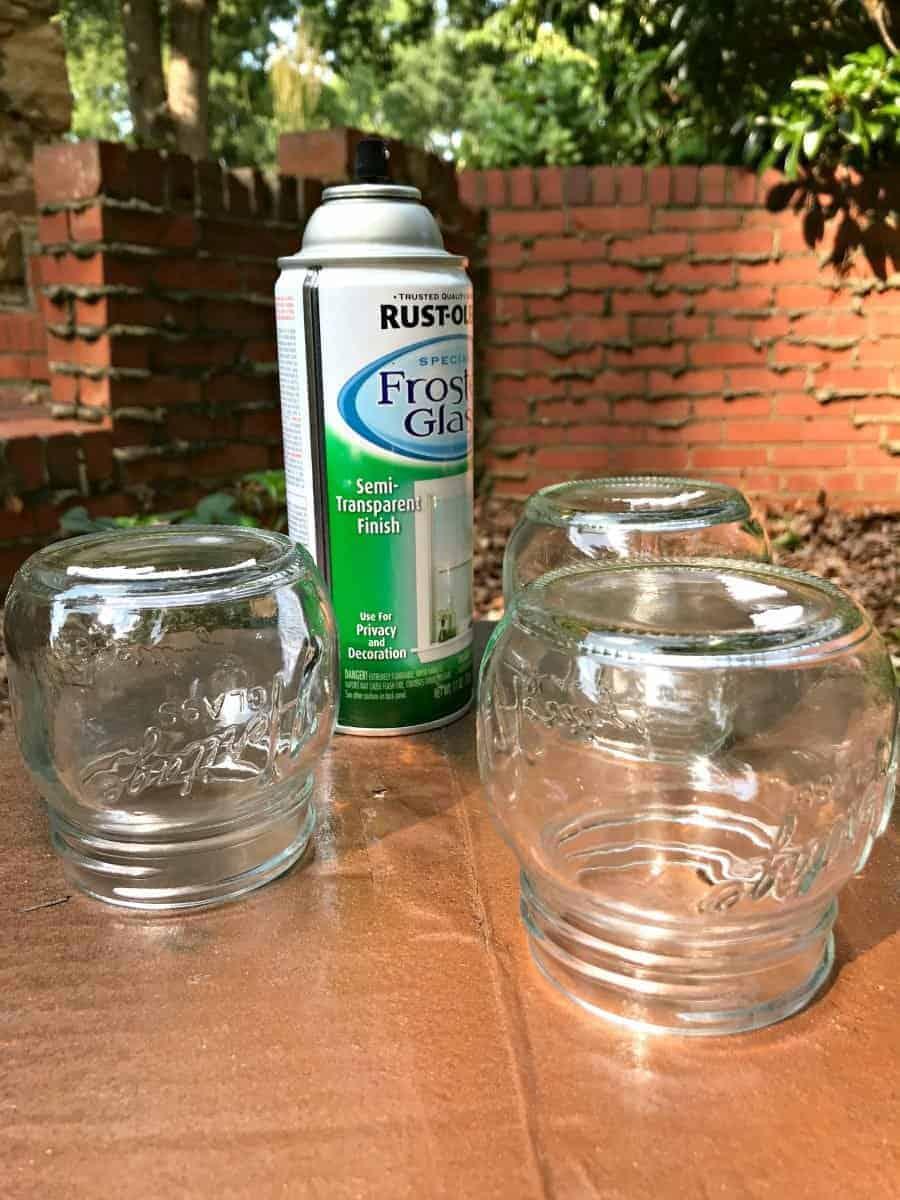 making DIY mason jar lanterns, spray paint and mason jars