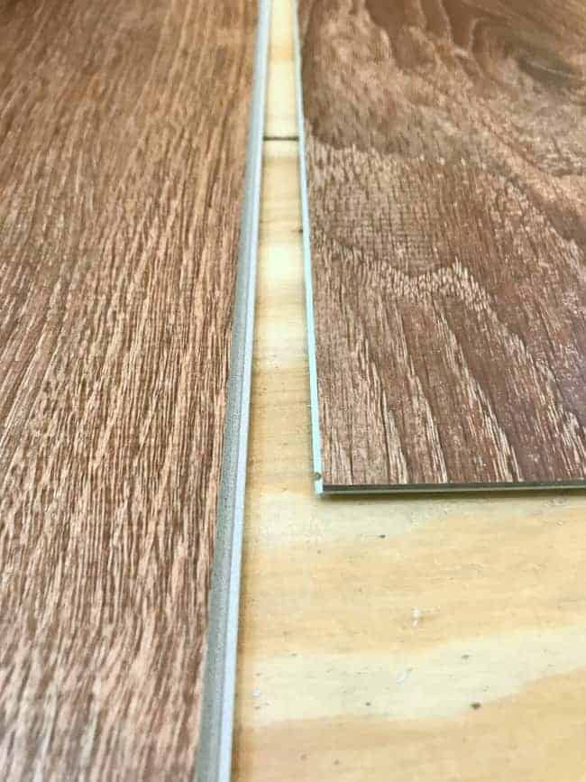 tongue and groove ends of vinyl plank flooring