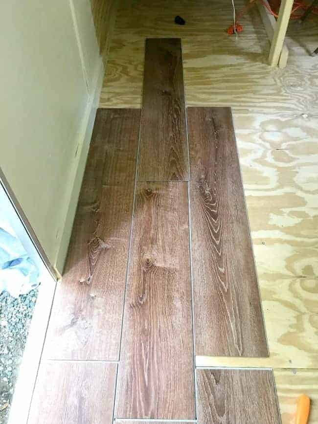 vinyl plank flooring laid out on plywood floor