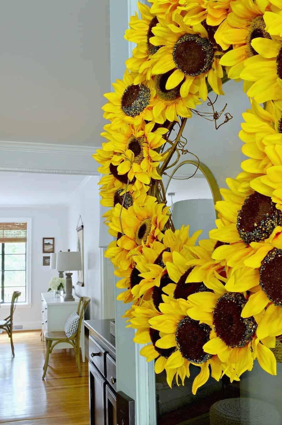 DIY sunflower wreath on front door, looking in cottage