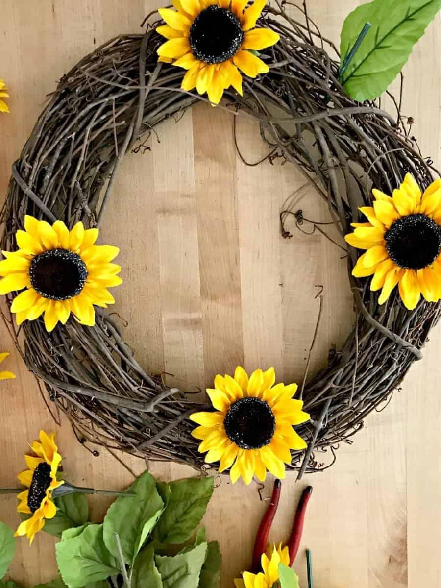 4 sunflowers equidistant in grapevine wreath form