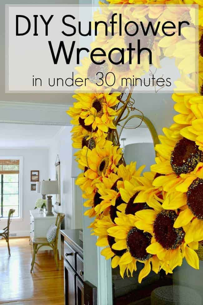sunflower wreath hanging on blue front door with pinterest graphic