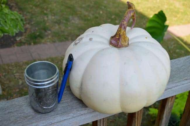 decorating for fall on a budget with a faux pumpkin, razor knife, and small mason jar