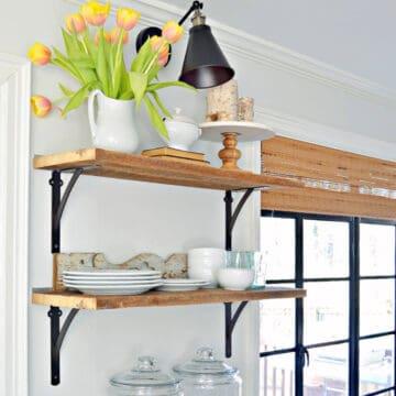 DIY wall sconce hanging over kitchen shelves