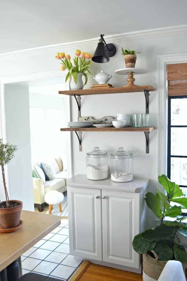 open shelves with dishes on kitchen wall