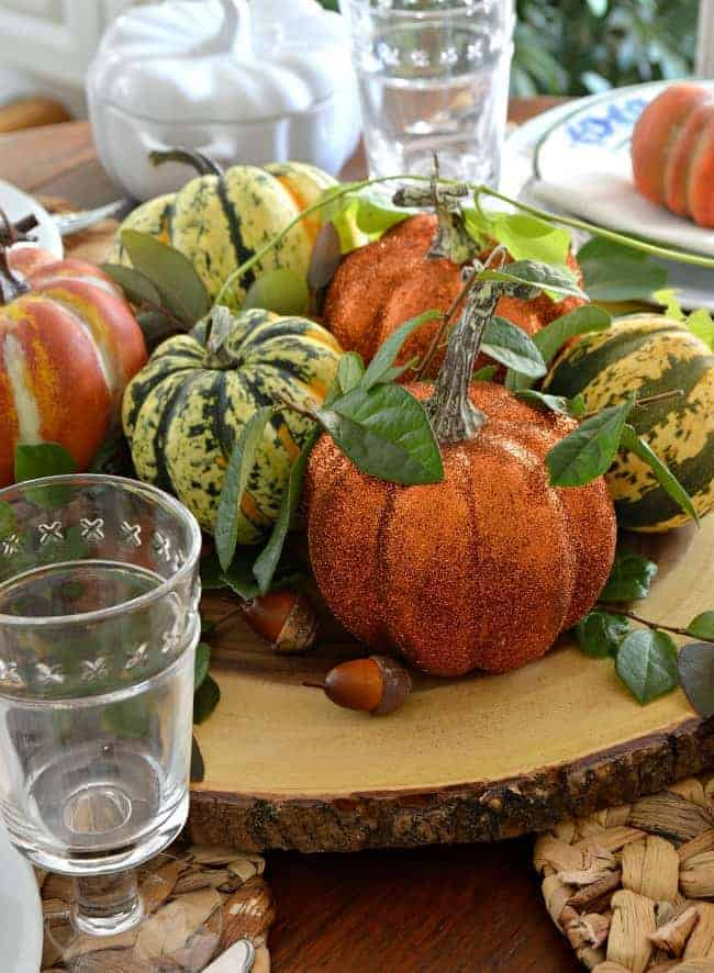 simple fall centerpiece with faux pumpkins and real pumpkin squash for a Simple Fall Tablescape Ideas post