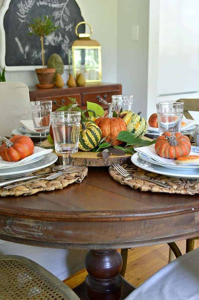 fall tablescape on round wood table