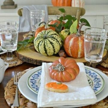 A table set with fall decor