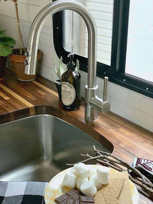 faucet and butcher block countertop in RV