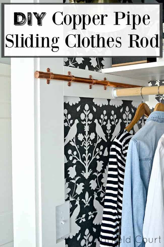 Copper pipe sliding clothes rod in small closet with bird wallpaper and a large graphic