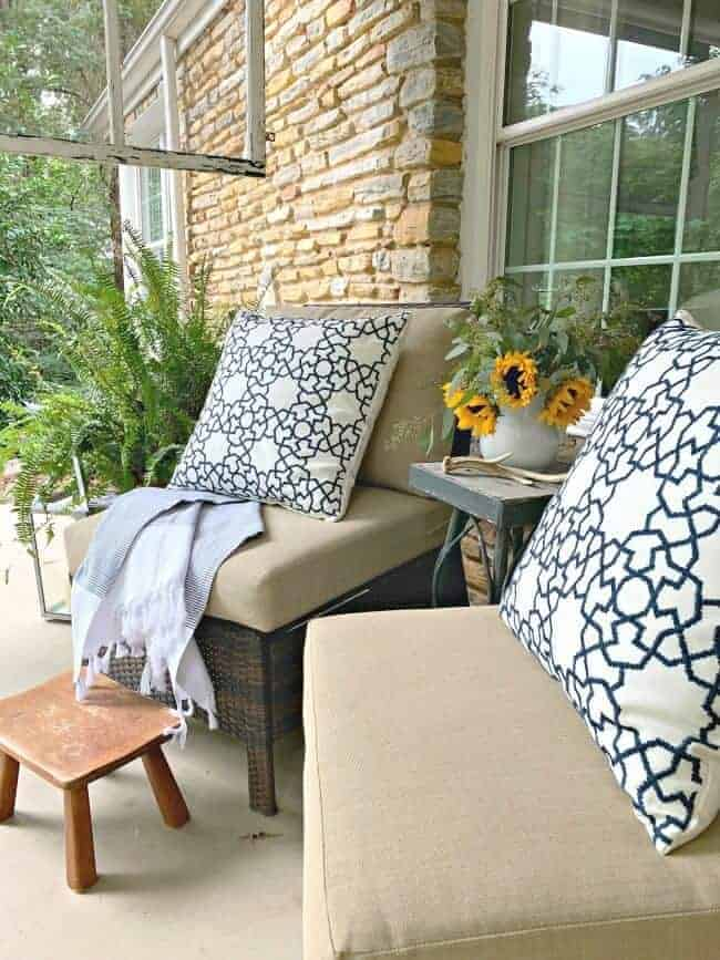 front porch fall decor with wicker chairs and blue and white pillows