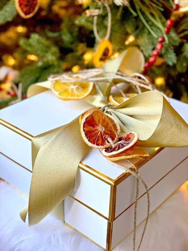 dried orange slice banner on white wrapped gift box