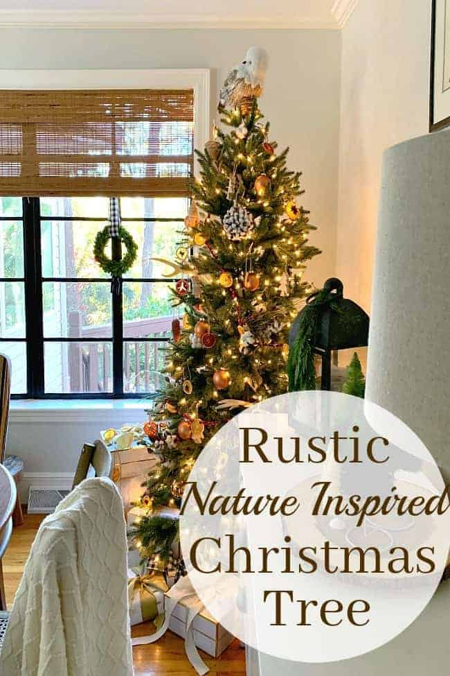 A Rustic Christmas Tree in a dining room corner with gifts underneath and a large graphic