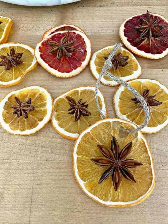 dried orange slice ornaments with star anise on cutting board