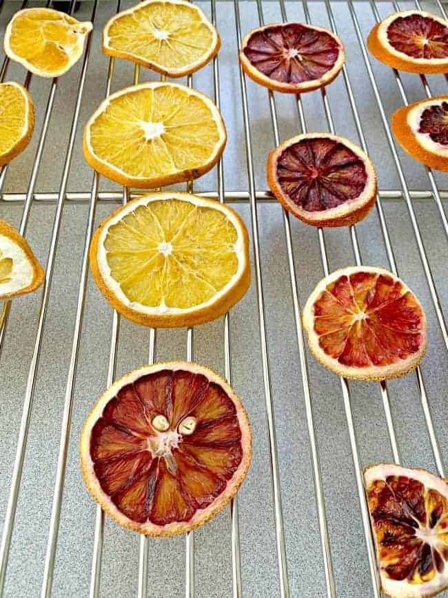 dried orange and blood orange slices on cookie cooling rack