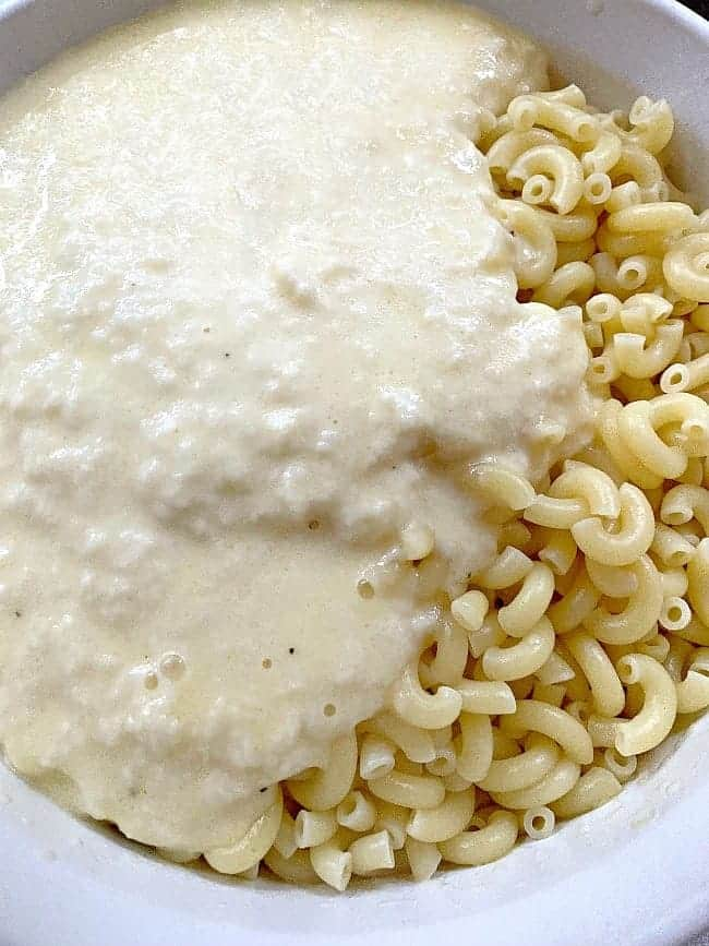 melted cheese and milk on cooked elbow noodles
