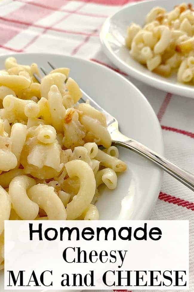 homemade cheesy mac and cheese on white dish with fork, with large graphic