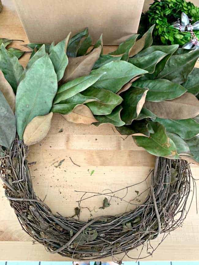 assembling a DIY magnolia leaf wreath