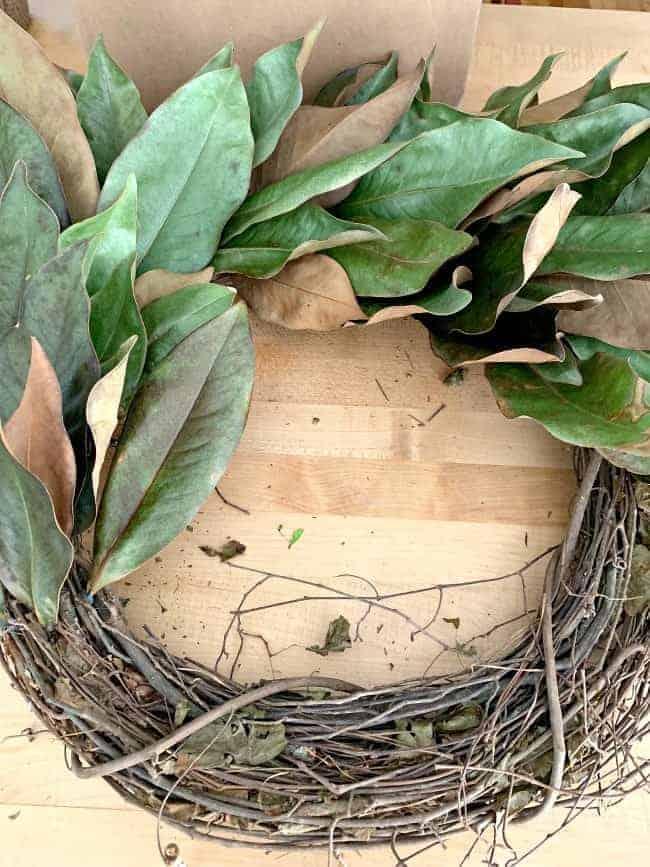 DIY Magnolia Leaf Wreath halfway complete