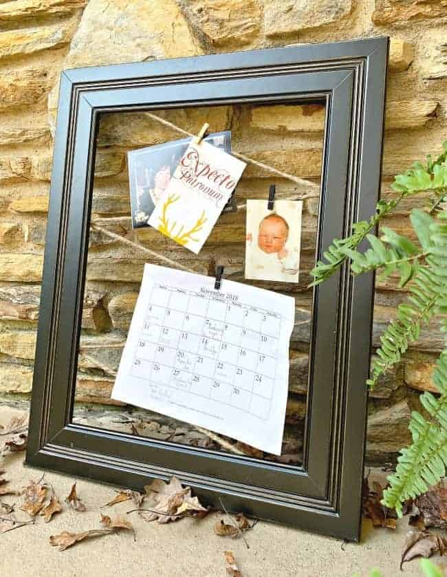 DIY memo board made with twine and large black frame