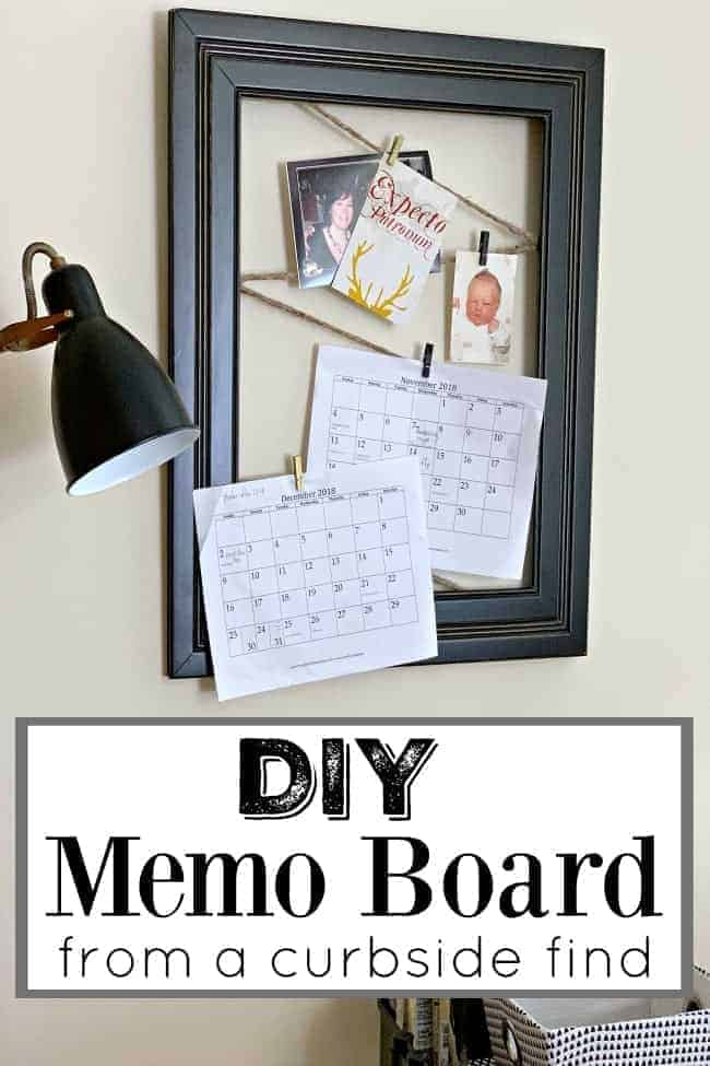 DIY memo board made with twine and large black frame hanging on wall with floor lamp next to it, plus a large graphic