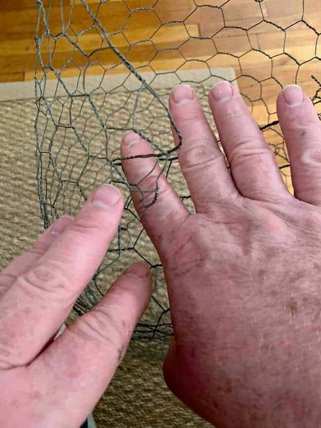 folding in end of chicken wire to create DIY lighted chicken wire Christmas balls