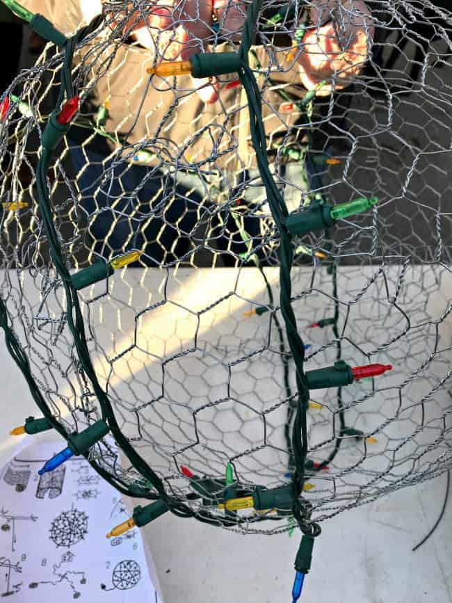 wrapping Christmas lights on chicken wire ball form