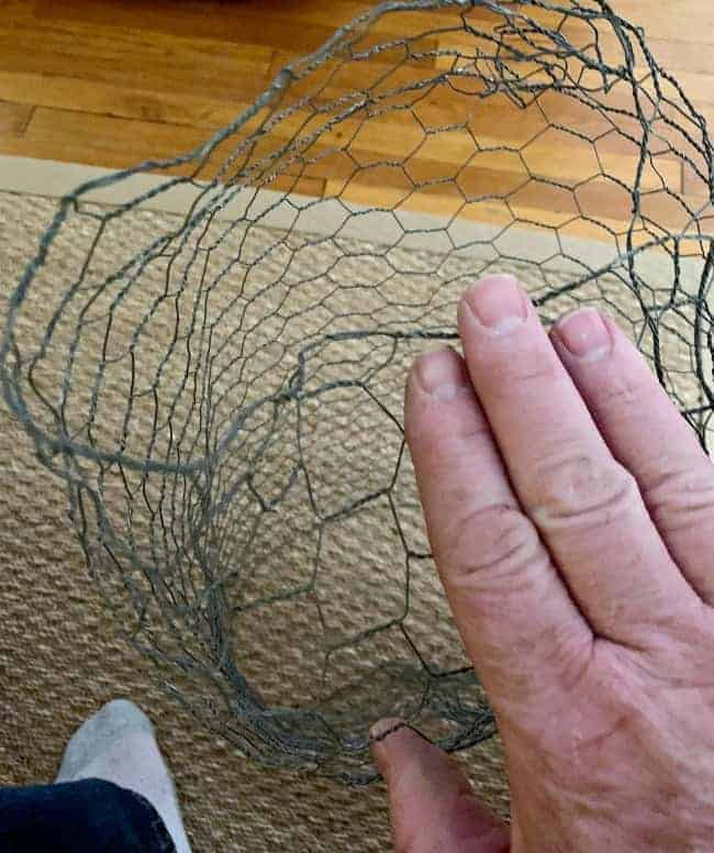 folding end of chicken wire to make DIY lighted chicken wire Christmas balls