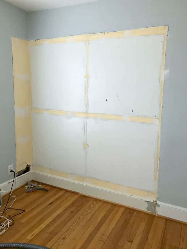 damaged wall in small bedroom