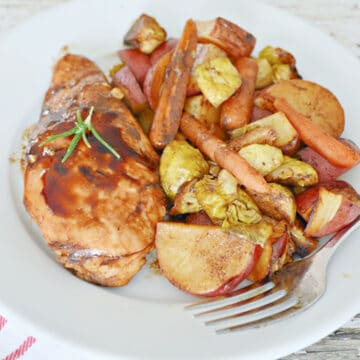 one pan chicken and vegetables served on white plate