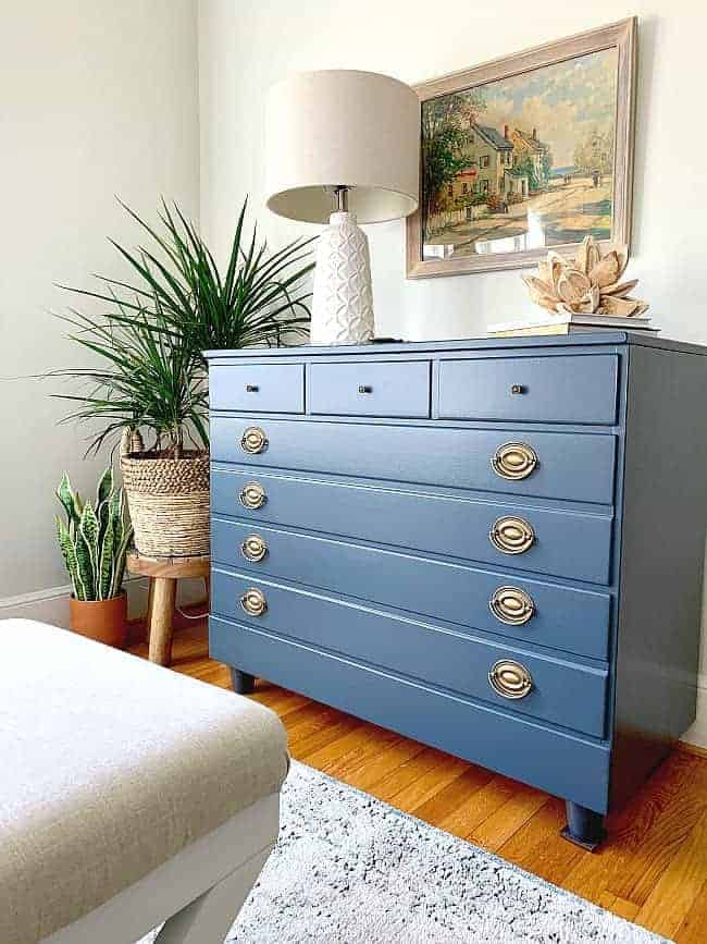 DIY Goodwill dresser makeover in navy in corner of bedroom