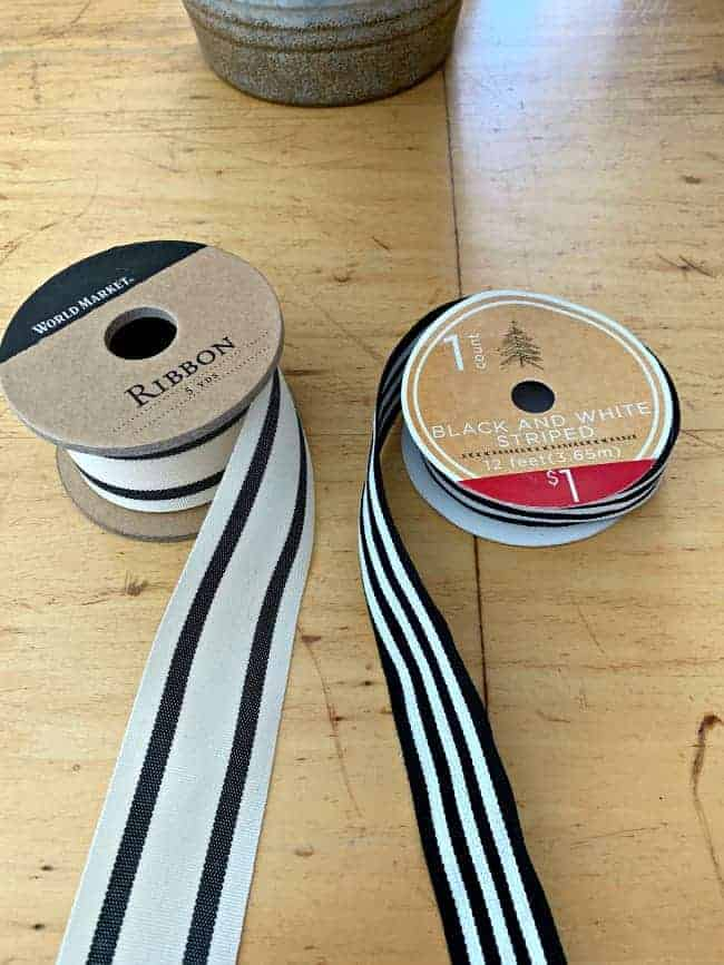 2 spools of black and white ribbon laying on table