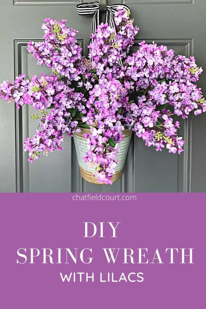 DIY lilac spring wreath hanging on dark gray door