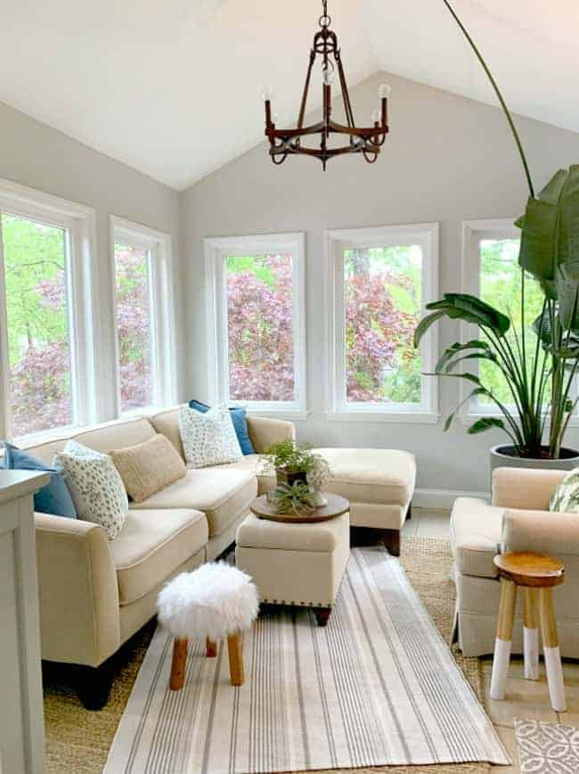 large neutral sectional in sunroom