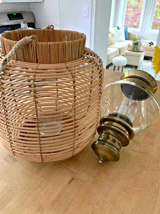 woven lantern and thrift store brass and glass light fixture