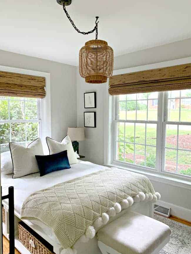 view of guest bedroom with platform bed and DIY rattan light fixture
