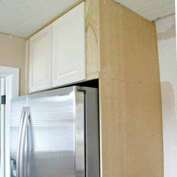 DIY refrigerator cabinet being built around a refrigerator