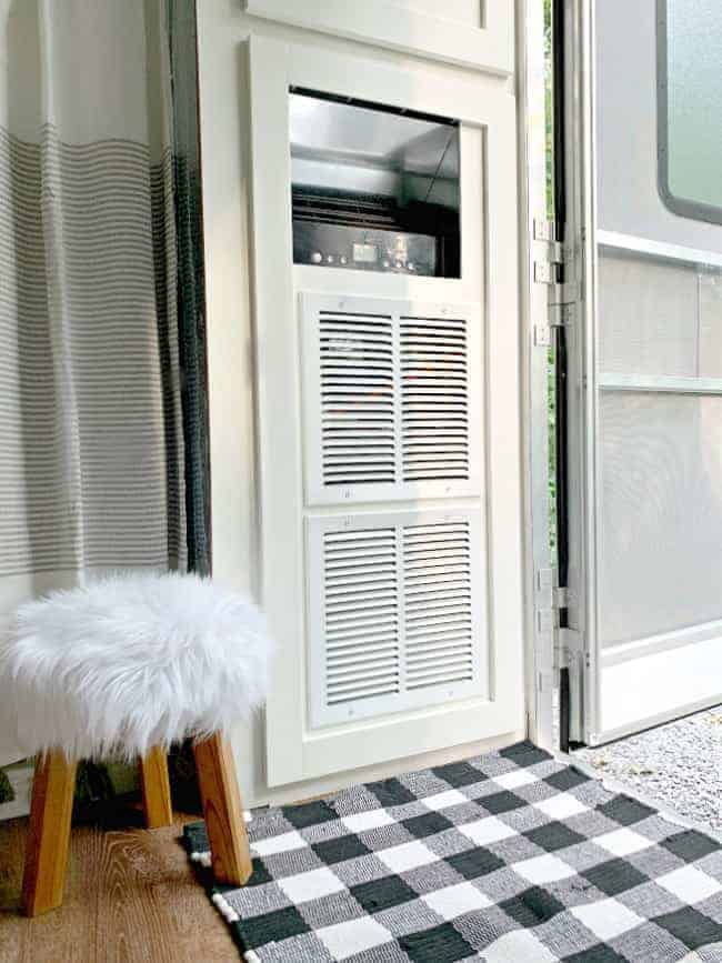 portable a/c cabinet with vents on the front and a faux fur wood stool