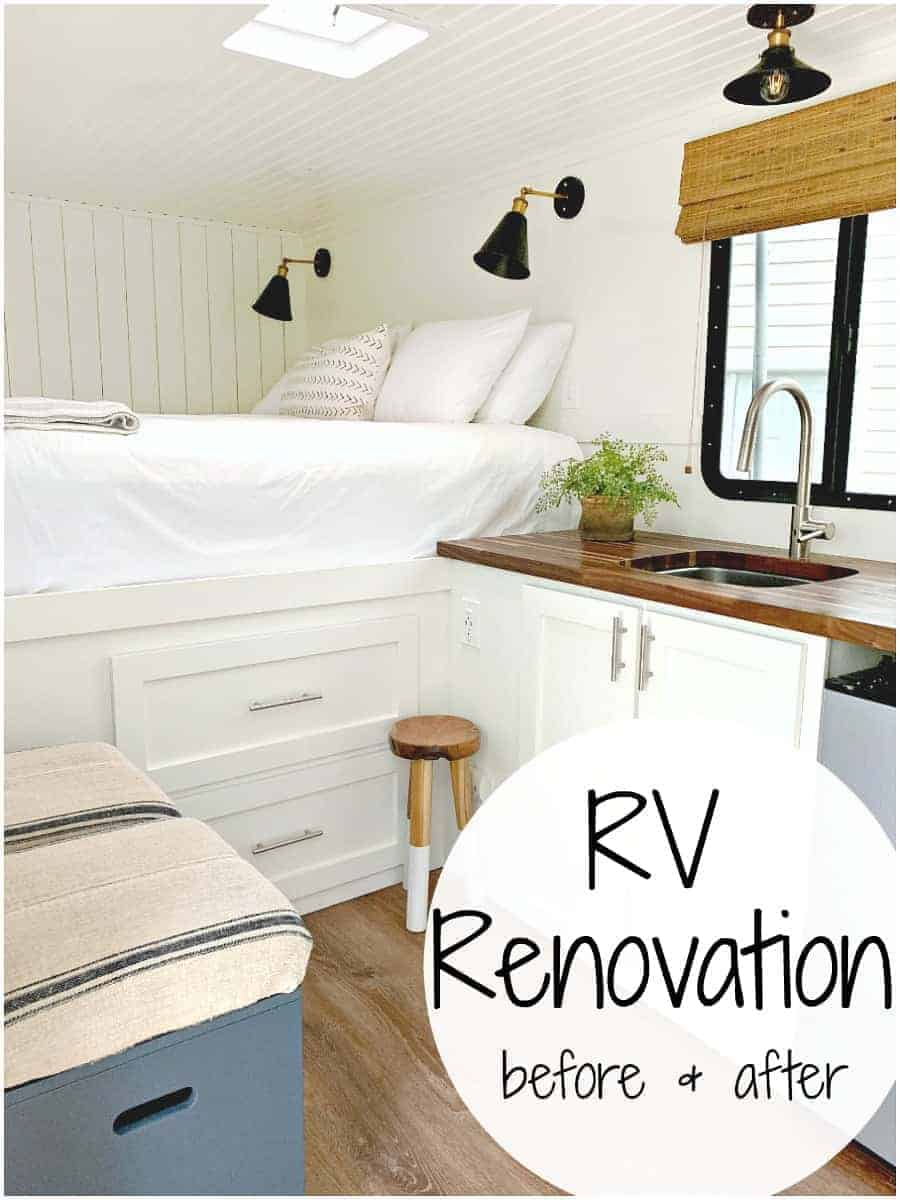 RV renovation after shot of a big white bed and kitchen sink, with a stool next to it.