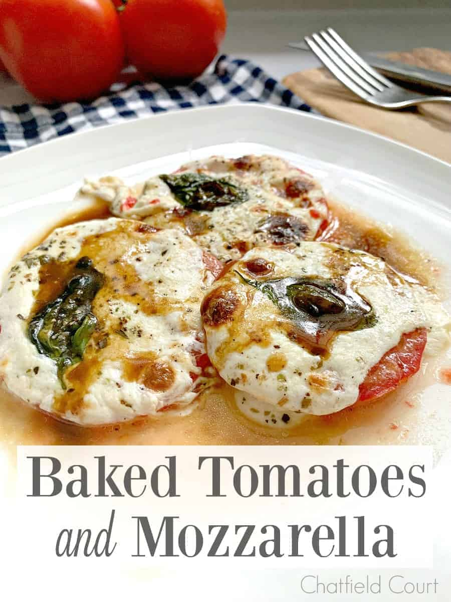 3 baked tomatoes and mozzarella on a dish with a large graphic