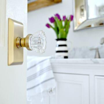 brass and glass door knob on a bathroom door