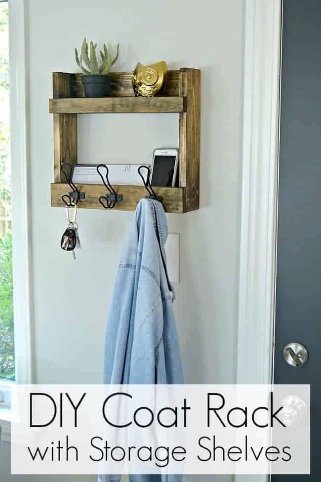 DIY coat rack with storage shelves hanging on wall next to dark gray door