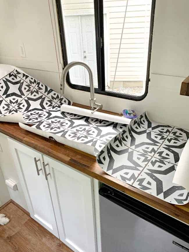 removable wallpaper panels laying on butcher block countertop in RV