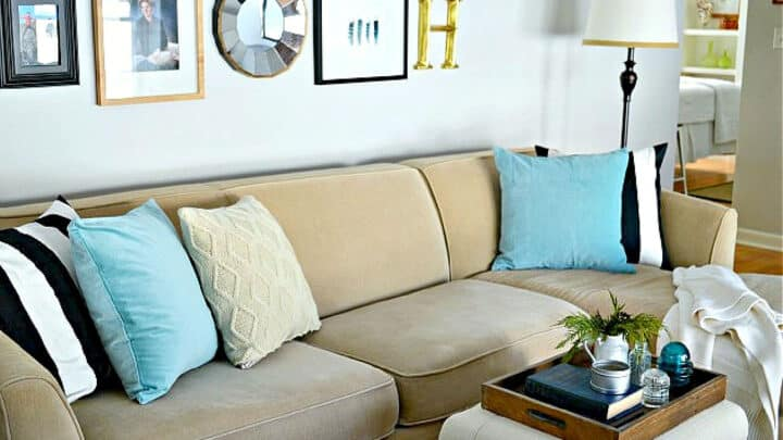 beige sectional sofa with blue pillows