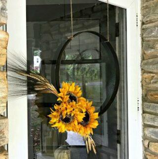 fall hoop wreath with sunflowers hanging on front door