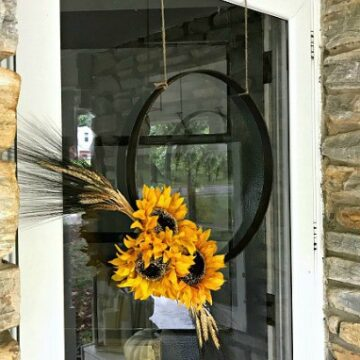 fall hoop wreath with sunflowers hanging on front door