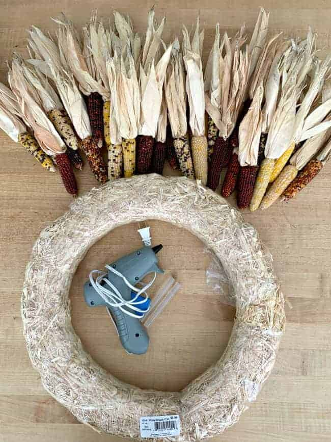 supplies to make DIY Indian corn wreath, hot glue gun, glue sticks, straw wreath form and mini corn cobs