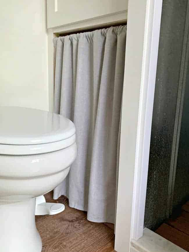 no sew curtain hanging in closet opening next to toilet