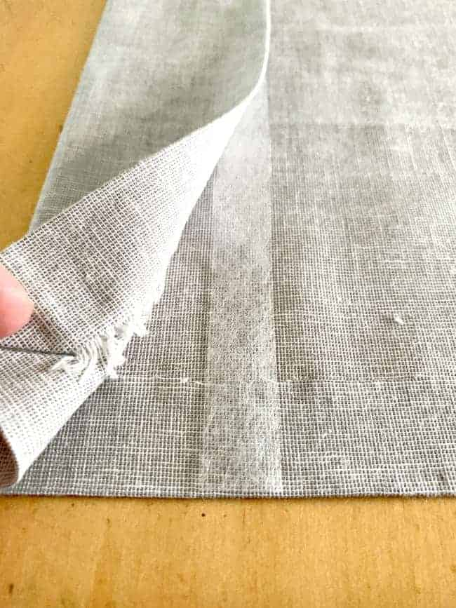 showing iron-on hem tape on cheap no sew curtain